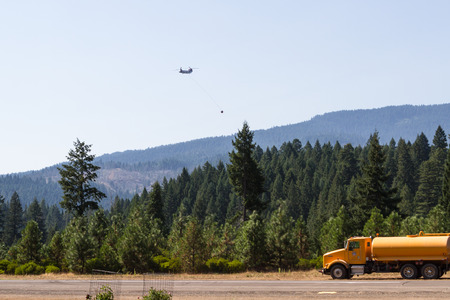 prospect: Prospect, Oregon - August 16 : Fire fighting helicopter returning for supplies at the airport to fight the National Creek Complex fire, August 16 2015 in Prospect, Oregon