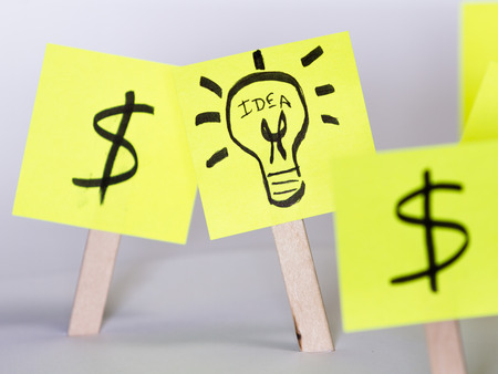 singular: concept image for a financial successful idea using sticky notes Stock Photo