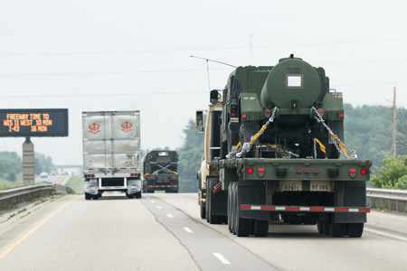 RELOCATED: Highway 9094,  Wisconsin - July 07 : Military vehicles being relocated from one base to another in the middle of the Jade Helm 15 exercise , July 07 2015 on highway 9094, Wisconsin