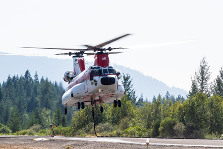 prospect: Prospect, Oregon - August 16 : Fire fighting helicopter lifting off from the Prospect Airport to fight the National Creek Complex fire, August 16 2015 in Prospect, Oregon
