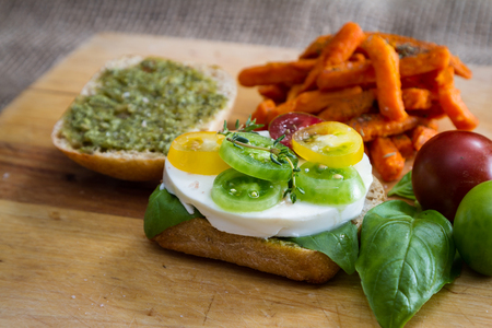 sliders: fresh mozzarella and tomato sandwich with fresh basil served with sweet potato fries Stock Photo