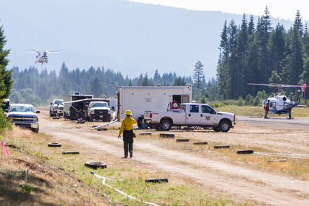 staging: Prospect, Oregon - August 16 : Fire fighters using the prospect airport as a staging area for the helicopters to fight the National Creek Complex fire, August 16 2015 in Prospect, Oregon Editorial