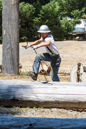prospect: Prospect, Oregon - August 15: Young man competing in the chocker setting event at the Jamboree and Timber Carnival, August 15 2015 in Prospect, Oregon Editorial