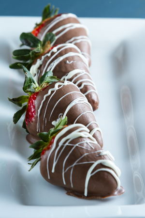 chocolate covered strawberries: delicious chocolate covered strawberries made at home with a milk chocolate swirl for a garnish