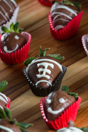 chocolate covered strawberries: delicious chocolate covered strawberries made at home with a milk chocolate garnished making the strawberries look like a playing ball Stock Photo