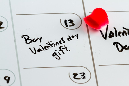 red condom: Day planner as a concept to remember to buy a valentines day gift