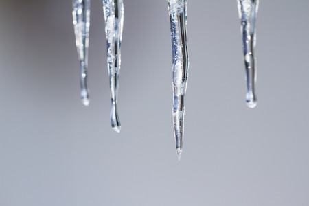 icicles hanging from the roof in an extreme cold and wet winter