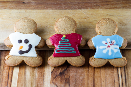 holiday gingerbread cookies decorated and laying on a wooden table