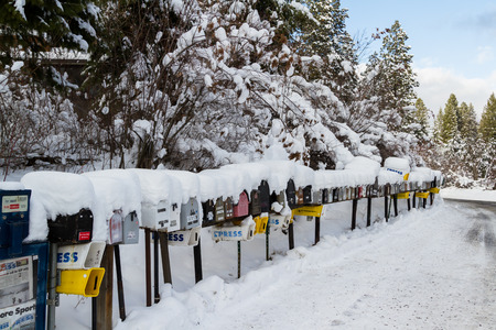 alene: Coeur d Alene, Idaho - December 30: Line of mailboxes set up on the road covered in snow and wintery record conditions, December 30 2016 in Coeur d Alene, Idaho