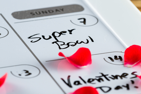close up of the words super bowl on sunday the 7th on a  2016 calendar