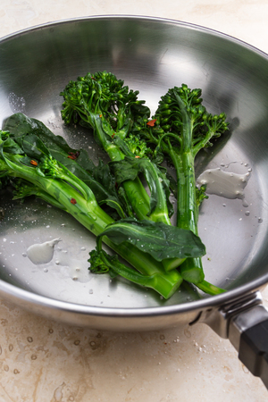 pepper flakes: organic broccoli saut�ed and seasoned with olive oil and red pepper flakes and sea salt Stock Photo