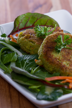 meat and alternatives: grilled falafels served over a fresh green salad with organic micro greens