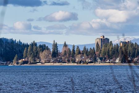 alene: Coeur d Alene, Idaho - December 16: beautiful winter day in lake CDA with an empty beach and the sun on the resort, December 16 2015 in Coeur d Alene, Idaho