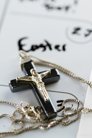 make belief: religious cross on a calendar on the date March 27 for a concept for Easter Sunday Stock Photo