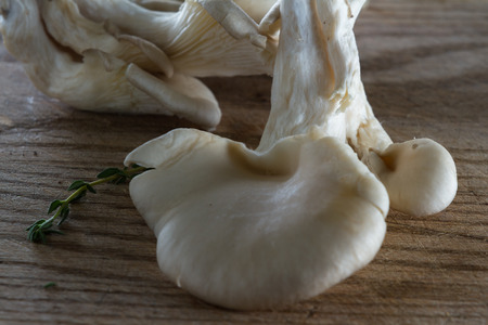 sourced: close up of a kitchen cutting board with organic raw mushrooms on it