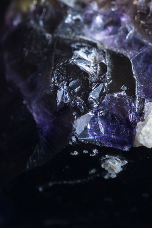 purples: close up of a beutiful piece of crystal with dark purples and yellow with clear sections