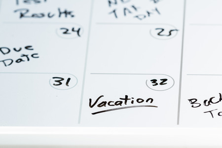 dry erase: close up of a dry erase calendar with vacation written on the 32 of a month