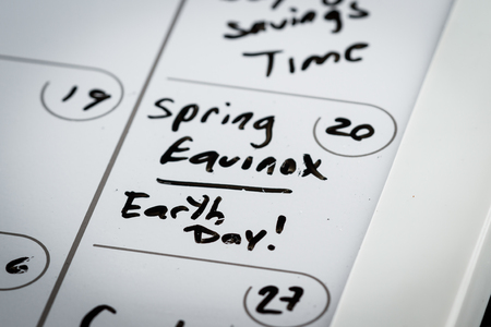 make belief: March 20th marked on a calendar as Spring Equinox and also Earth Day concept for 2016