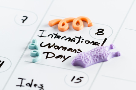 make belief: march 8th on a day planner with the words International Womans Day marked on it
