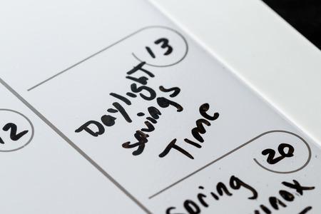 daylight savings time: March 13th on a calendar marked with daylight savings time with aback marker Stock Photo