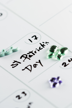 march 17th: St Patricks day marked on a calendar on march  17th with spring green props Stock Photo
