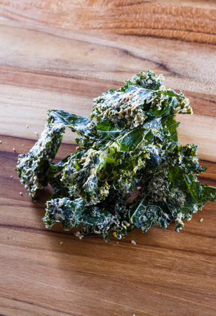 detoxing: close up of a kale chip covered with melted parmesan cheese and spices