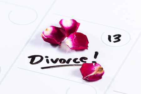 dry erase: the word divorce hand written on a dry erase calendar with a dead rose next to it Stock Photo