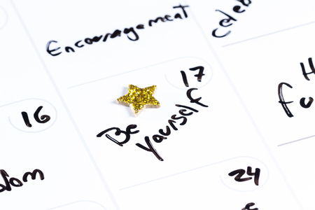 allocated on white: dry erase calendar with different positive messages on every different day as a concept for a positive good month