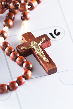 dry erase: concept for Easter in 2017 using rosary beads and a dry erase calendar Stock Photo