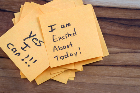 free me: close up of small sticky notes on a wooden desk , all with different positive notes Stock Photo