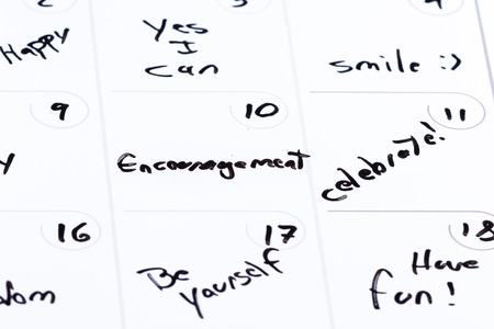 dry erase calendar with different positive messages on every different day as a concept for a positive good month