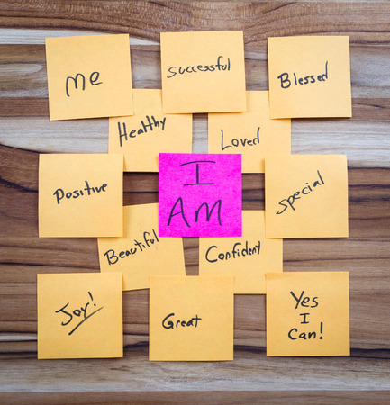 self help: very powerful self help concept using positive messages and a I am floating above all the positive thoughts Stock Photo