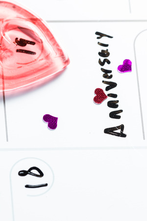 in loving memory: concept for an anniversary marked on a calendar with hearts