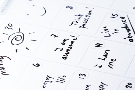 dry erase: dry erase calendar with different positive messages on every different day as a concept for a positive good month