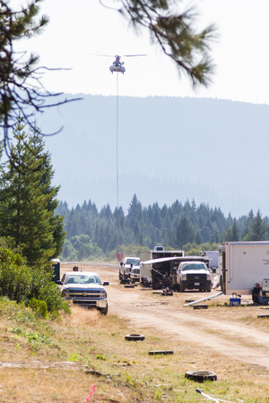 returning: Prospect, Oregon - August 16 : Fire fighting helicopter returning for supplies at the airport to fight the National Creek Complex fire, August 16 2015 in Prospect, Oregon