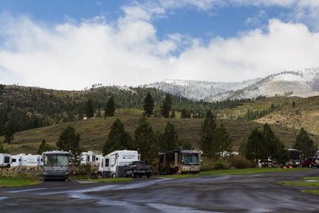 rv: Gold Ranch RV resort, Verdi, Nevada - April 25 : Snow on the mountains behind a busy RV park, early spring, April 25 2015 Gold Ranch RV resort, Vardi, Nevada.