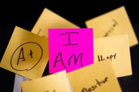 free me: empowering self help message with the words I am in focus and all around it in and out of focus other positive thoughts and words