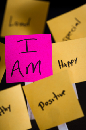 self help: empowering self help message with the words I am in focus and all around it in and out of focus other positive thoughts and words