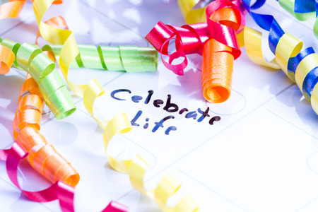 dry erase: concept image for celebrating life using a dry erase calendar and curly ribbon Stock Photo