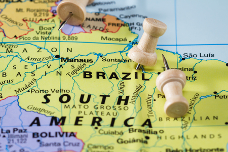 law of brazil: push pin on  a world map marking Brazil as a destination concept