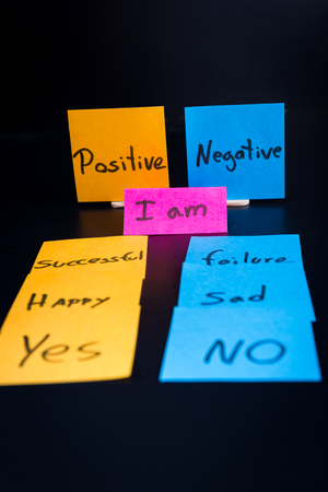 low self esteem: concept of duality using sticky notes with antonyms on a dark background