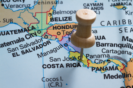 marking up: close up of  a map with Costa Rica in focus and a pin marking the spot Stock Photo