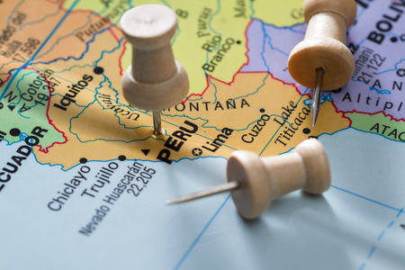 imaginary line: close up of a world map with the word peru in focus