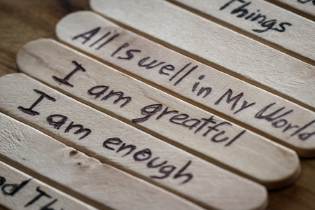 close up of a hand written message on a icesicle stick as a self esteem building concept