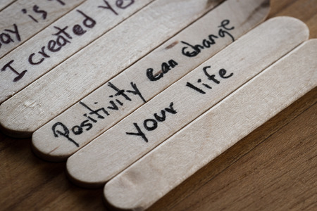 provoking: close up of a hand written message on a popsicle stick as a self esteem building concept