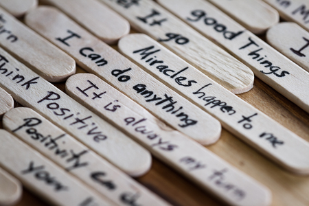 provoking: close up of a hand written message on a icesicle stick as a self esteem building concept