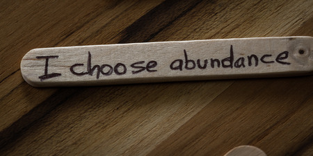 abundance: close up of a hand written message on a icesicle stick as a self esteem building concept