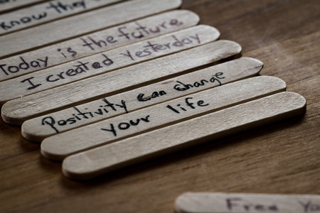 esteem: close up of a hand written message on a icesicle stick as a self esteem building concept