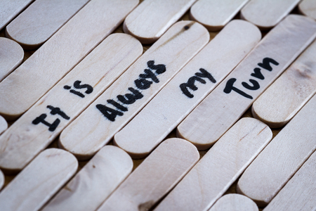 self help: concept for self help using empowering words on a wooden icesicle stick