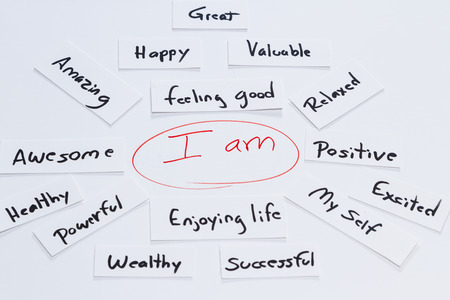 self help: self help concept image using the words I am and adding positive ideas and concepts Stock Photo